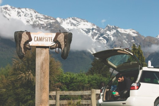 MWCG - sign w-boots car mountains